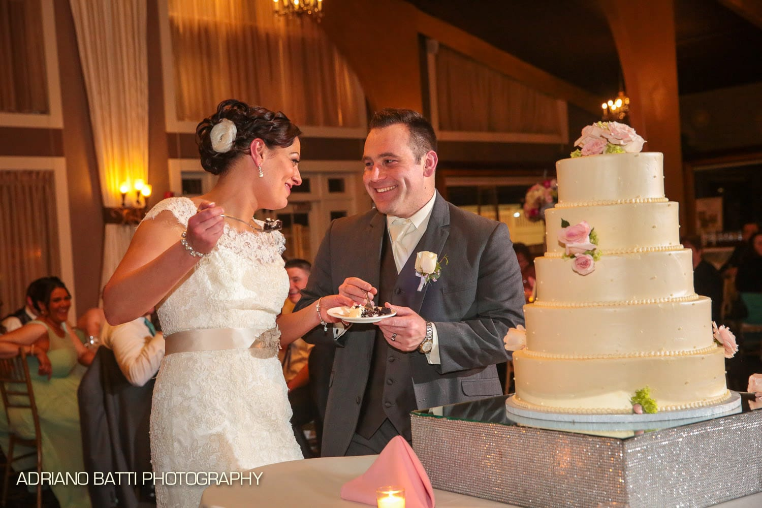 A couple cuts the cake in the Harborview Ballroom