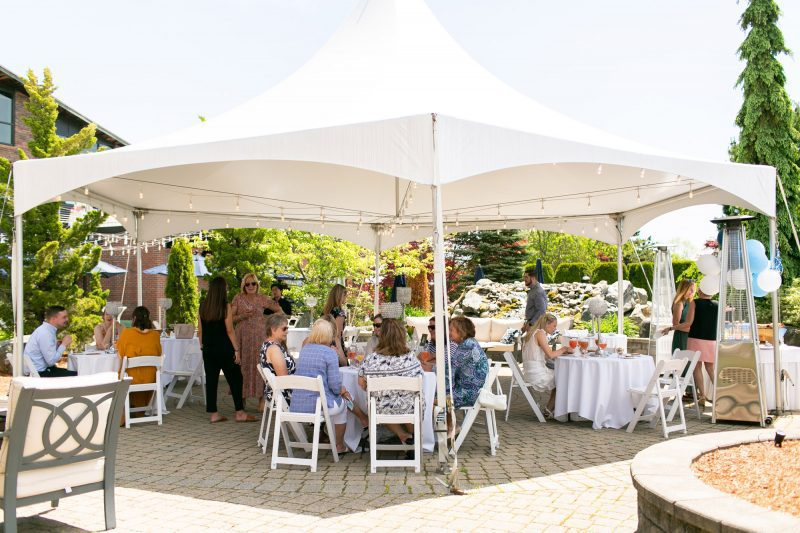 Guests enjoying Lighthouse Point Courtyard at Danversport