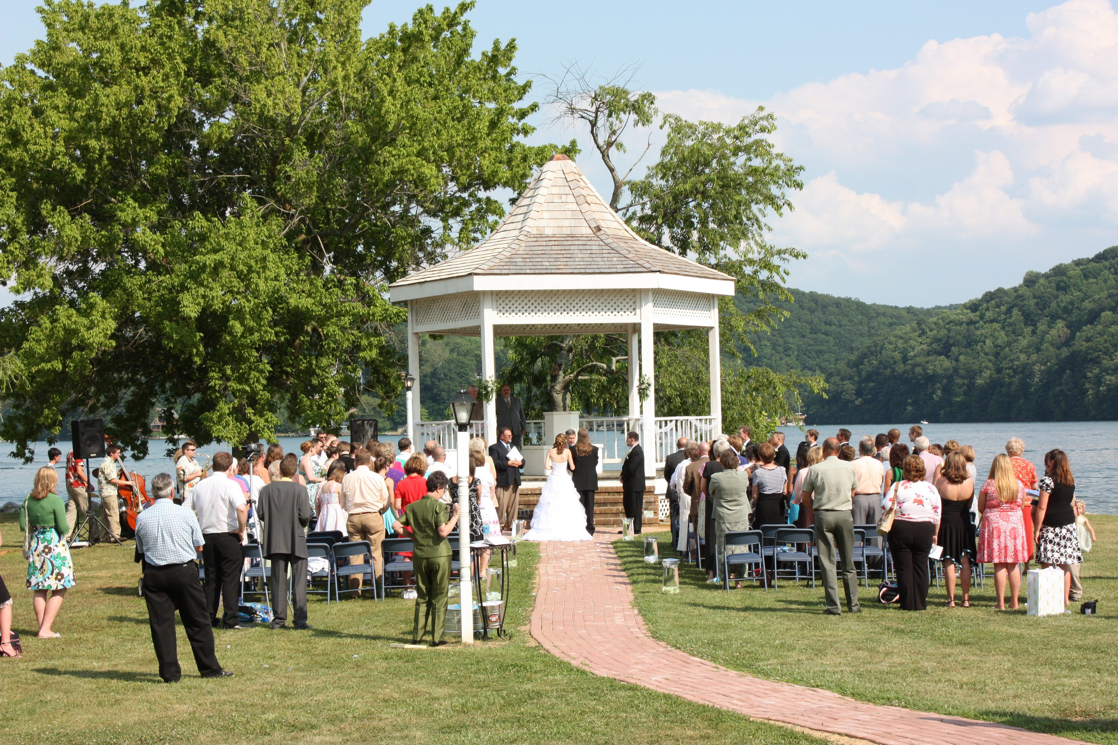 Waterfront wedding ceremony outside on a gazebo on a bright, sunny day
