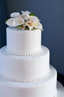 Plain wedding cake with flowers on top