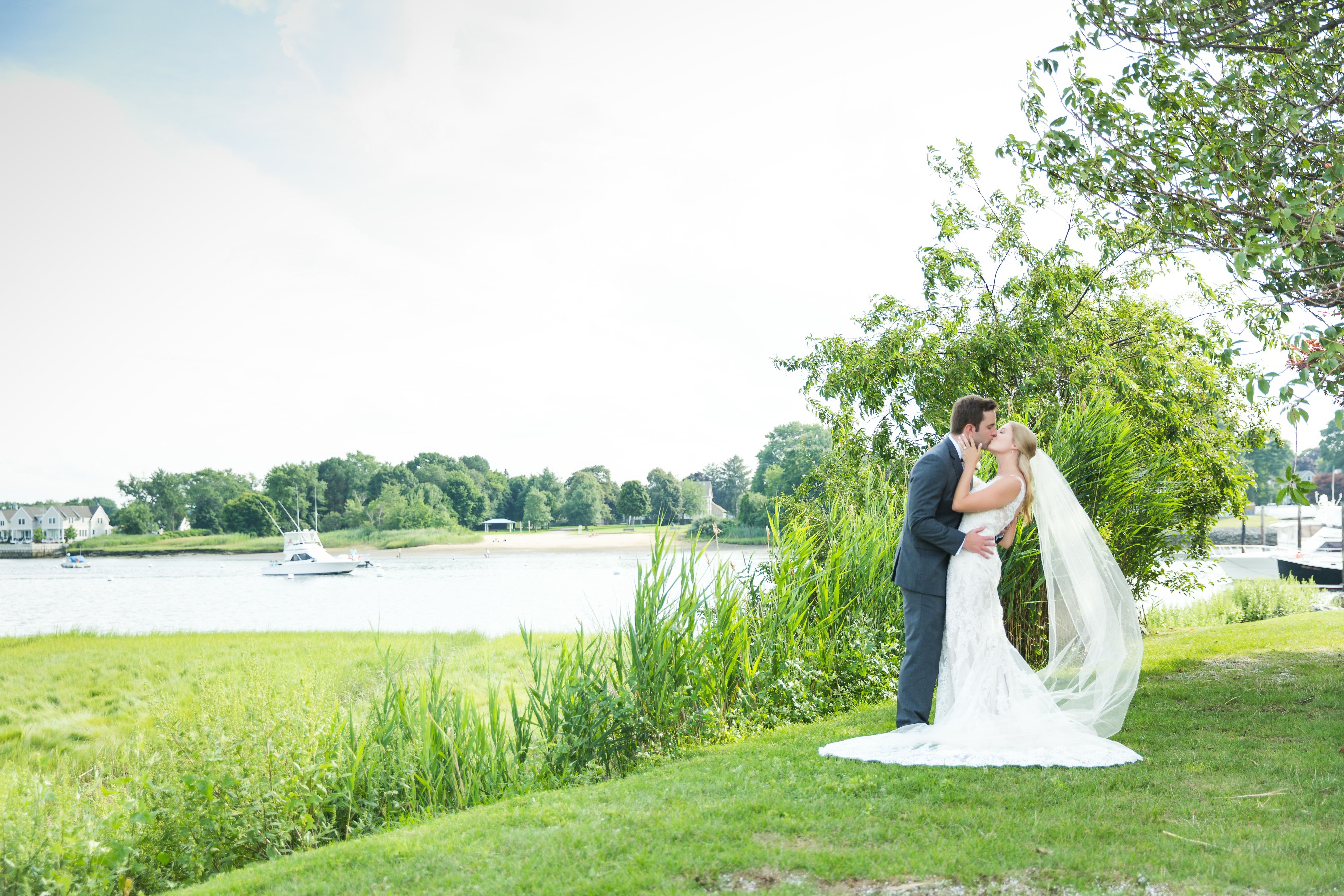 Ashley- Bridal Series Interview- Bride & Groom Kissing By Water