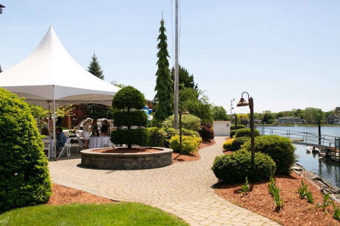 Lighthouse Point and Courtyard with tented space, surrounded by the marine at Danversport in Danvers, Massachusetts