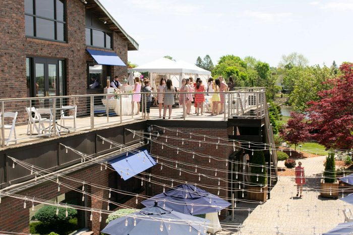 Guests enjoy the Sun Deck attached to the Harborview Ballroom at Danversport in Danvers, Massachusetts