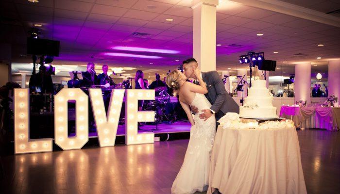 Couple kissing in Danversport's Terrace Ballroom